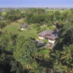 Aerial from front right of villa The Arsana Estate
