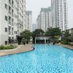 Featured Image Elegant Pool View 2BR Cosmo Mansion Apartment